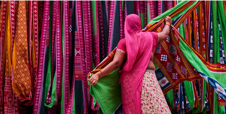 Women with colorful fabrics